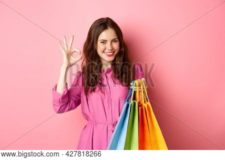 Young Happy Woman Shopper Showing Okay Sign, Pleased With Good Discounts, Buying Staff On Sale, Hold