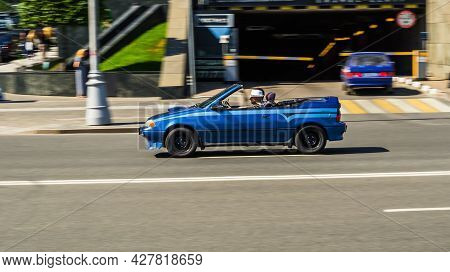 Moscow, Russia - July 2021: Geo Metro Convertible Old Car Moving In The Street. Blue Suzuki Swift Co