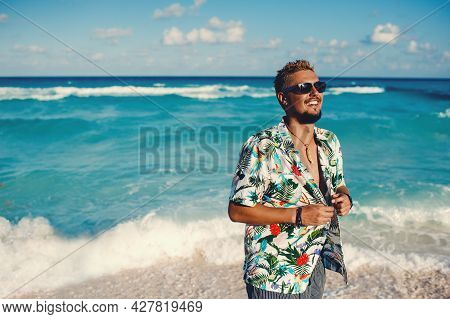 Handsome Happy Man Wearing Hawaiian Shirt At The Sea Or The Ocean Background. Travel Vacation Holida