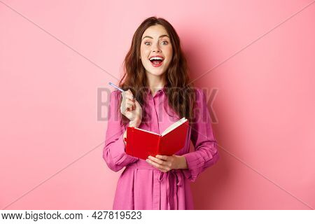 Excited Young Woman Have Excellent Idea, Writing Down Her Ideas In Planner, Holding Notebook Diary A