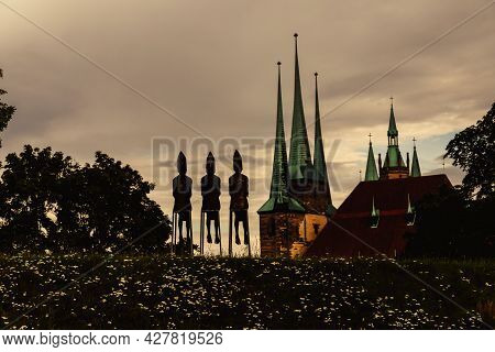July, 2021, Erfurt Germany, Church Of St. Severus And Three Bishops Sculptures In The Evening