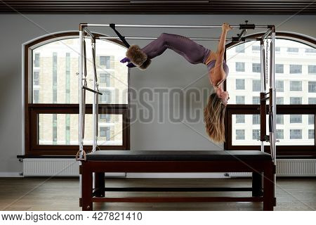 Pilates Aerobics Instructor Woman In Fitness Exercise On Cadillac Reformer, Musculoskeletal System T