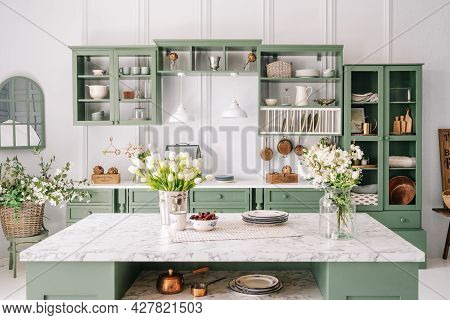 Spacious Kitchen With Vintage Design, Counter With Marble Top And Flowers In Metal Bucket On It, Org