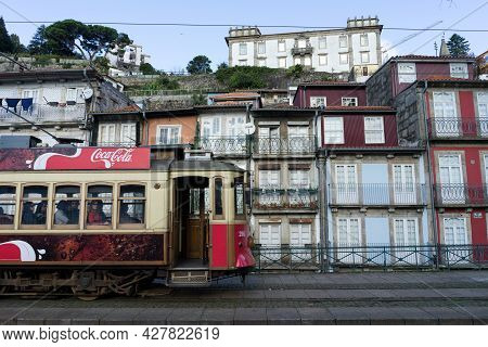 Porto, Portugal - December 01, 2019: Tram City Tour Of Porto With The Typical Houses In The Backgrou