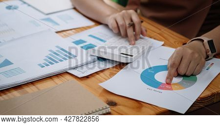 Close Up Of Accountant Hands Make Audit Of Expenses Calculate Charges Based On Paper Documents. Crop