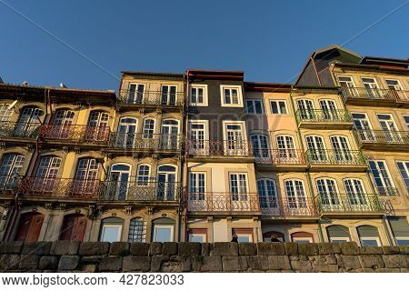 Porto, Portugal - December 01, 2019: Facades Of The Typical Houses Of Porto In The A Ribeira Zone At