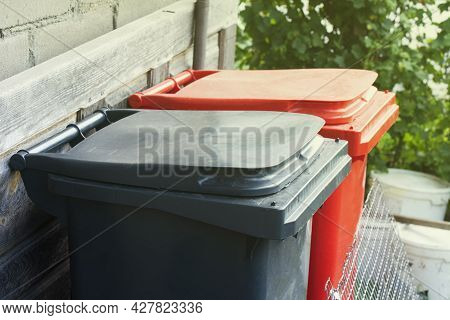 Two Recycling Garbage Containers Red And Gray Color. Colorful Recycle Bins Outdoor. Minimal Waste Se