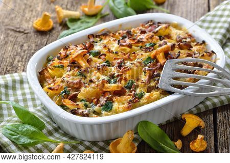 Chanterelle Pasta Casserole With Spinach Leaves And Cheese Served Hot From The Oven