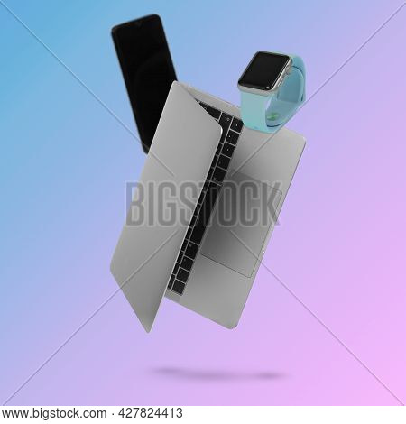 Creative Idea With A Toilet Bowl And Various Flowers Flying In The Air On A Light Pink Background.mi