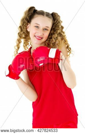 Happy Teenage Girl Posing In Red Boxing Gloves. Cheerful Smiling Teenage Girl Boxer With Curly Ponyt