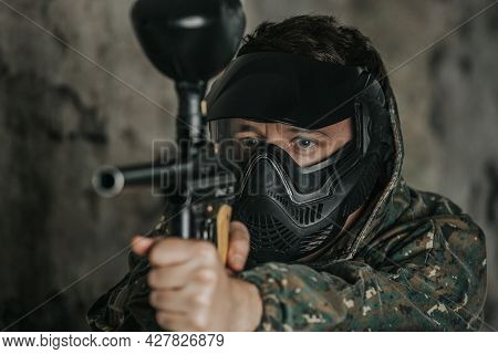 Portrait Of Paintball Player, Game In Which Participants Simulate Military Combat Using Air Guns To