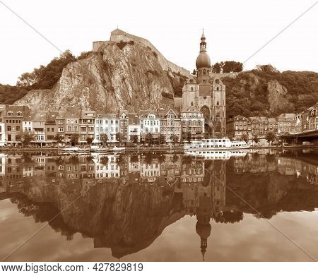 Reflections Of The The Citadel And The Collegiate Church Of Our Lady On The Meuse River, Dinant, Bel
