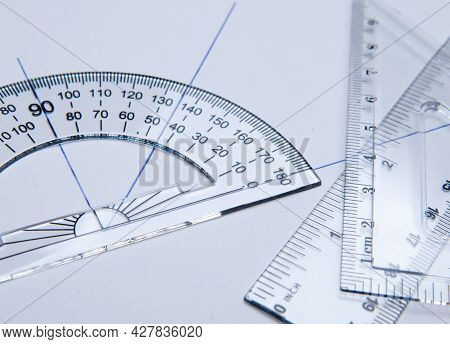 Shool Materials For Drawing: Bevel, Square And Angle Meter On A White Paper. Back To School