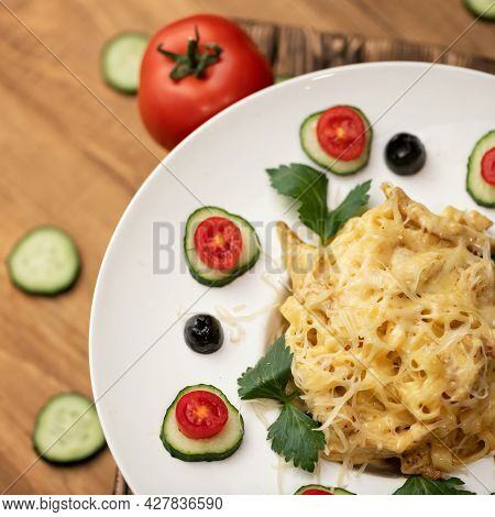 Spaghetti With Melted Cheese, Garnished With Slices Of Cucumber, Tomato And Parsley Or Celery. Gourm
