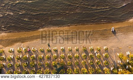 Sand Beach Aerial, Top View Of A Beautiful Sandy Beach Aerial Shot With The Waves Rolling Into The S