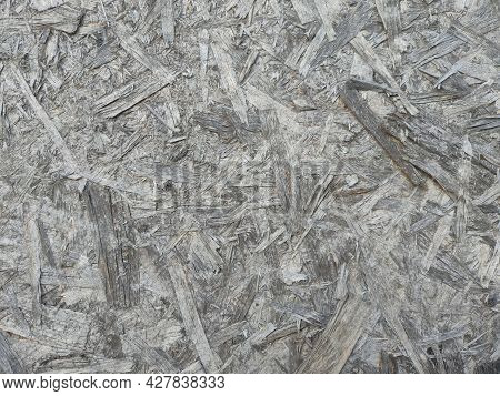 Texture Of An Old Oriented Chipboard That Has Faded In The Sun