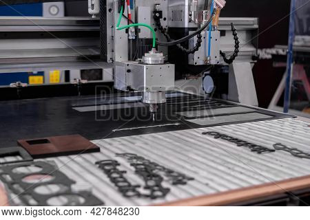 Automated Cnc Turning Milling Machine Cutting Sheet Metal At Factory, Exhibition, Plant. Metalworkin