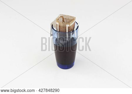Freshly Brewed Glass Of Coffee Pour Over Method With Paper Drip Bag. How Make Coffee At Home With Al