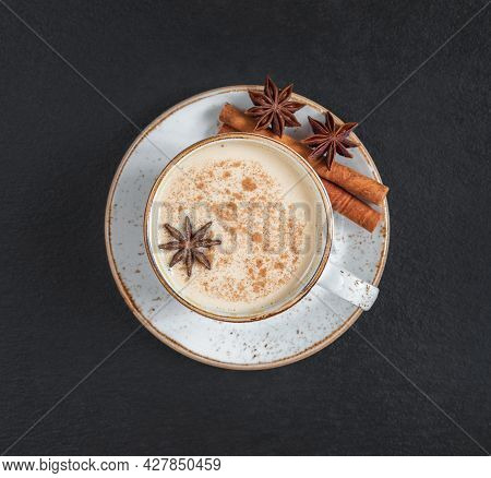 Masala Chai Tea On A Dark Background Close Up. Traditional Indian Hot Drink With Milk And Spices. To
