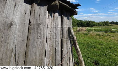 Village Building Old Boards. An Farm Barn Or Woodshed. Summer.