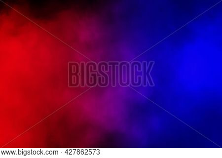 Abstract Image Of Colorful Smoke Or Fog In Black Background.