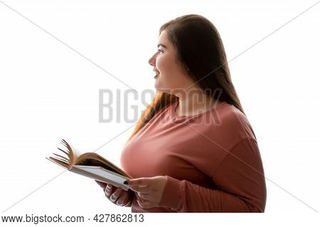 Dreamful Woman. Book Reader. Romantic Hobby. Body Positive. Thoughtful Happy Overweight Young Woman