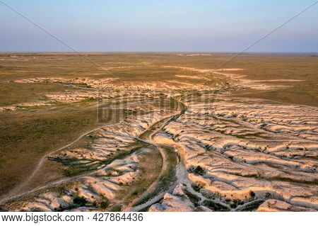 afternoon light over arroyo and badlands in Pawnee National Grassland in northern Colorado, summer scenery aerial view of Main Draw area