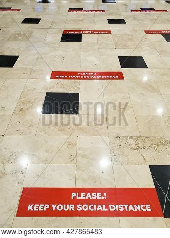 Red Lines With Social Distance Precaution In English On Tiled Floor At Airport Antalya, Turkey. New