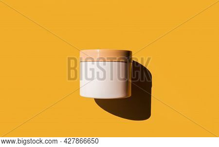 Advertising Isolated Container On Bright Sunny Yellow Background. Skincare, Bodycare Beauty Product