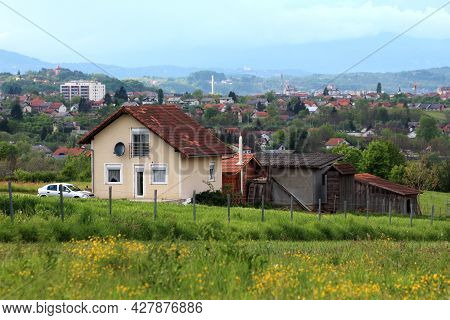 Landscape View Of Idyllic Small Country Town Spreading Into Distance With Family Houses And Small Bu