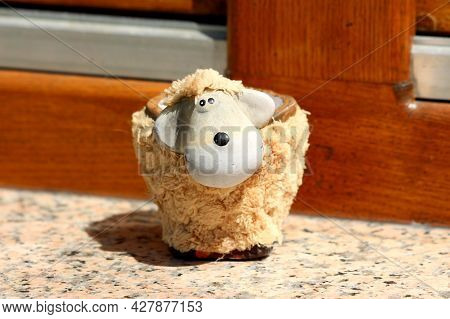 Strange Funny Looking Ceramic Toy Sheep Mug Covered With Fluffy Plush Left Outside On Top Of Marble