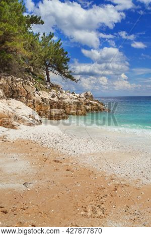 Summer Vacation Background With Turquoise Sea Water Bay And Pine Trees In Greek Island, Marble Beach