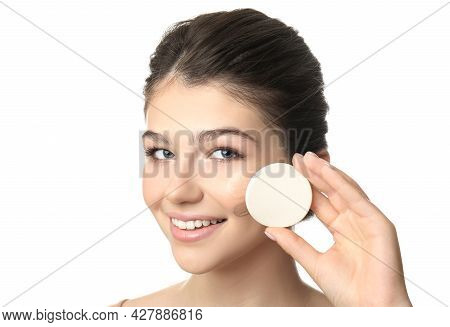 Beautiful Girl With Sponge On White Background. Using Concealer And Foundation For Face Contouring