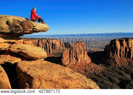 Hiker Injoying The View Of  Monument Canyon, Colorado National Monument, Grand Junction, Usa