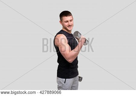 Man Pumping Biceps With Dumbbell. Sprotsman Doing Traning On Biceps Muscles. Gym, Lifting Sport Conc