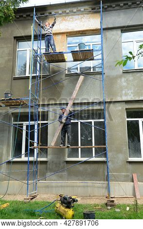 Kyiv, Ukraine - April, 05, 2021: The Building Contractors Are Transforming, Moving Scaffolding To Re