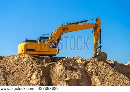 An Industrial Excavator Closeup Develops In A Sandpit Quarry. Industry, Technology, Mining. Heavy In