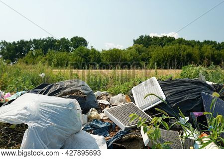Big Rubbish Dump Neare The Road, Nature And Blue Sky Background