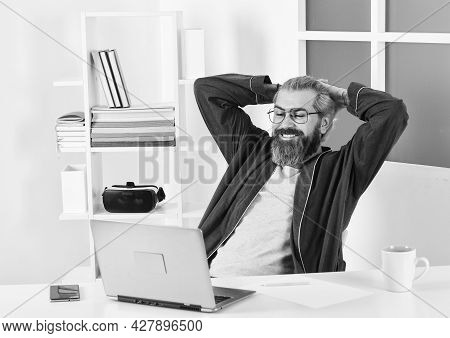 Online Education Or Social Media Concept. Freelancer Working From Home. Man Sitting At Home And Work