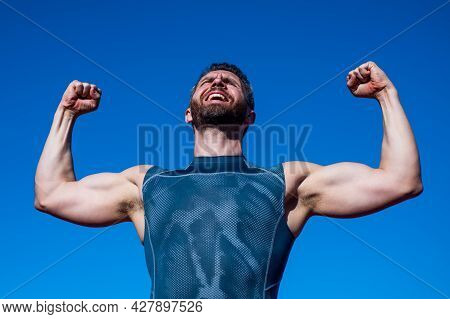 Happy Athletic Muscular Man Has Biceps And Triceps, Sport Success