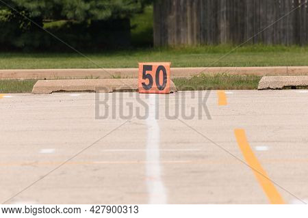 A Fifty Yard Line Marker Ready For Rehearsal At Marching Band Rehearsal