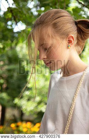 Beautiful Teenager Girl Walks In The Park. Walk In Nature In Summer