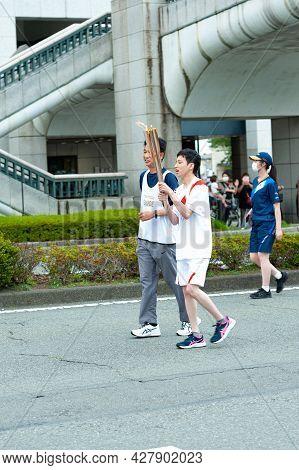 Fuji City, Shizuoka-ken, Japan - June 24, 2021: Tokyo 2020 Olympic Torch Relay In Fuji City.