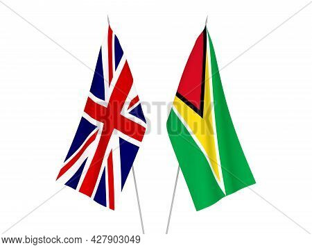 National Fabric Flags Of Great Britain And Co-operative Republic Of Guyana Isolated On White Backgro