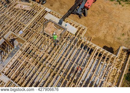 Wood Building Frame On New Residential Construction Home Framing Home A Boom Truck Forklift In The N