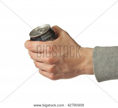 Hand Holding Closed Can Of Soda
