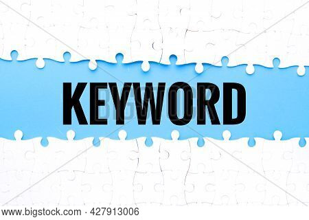 Split Puzzle With Keyword Word On Blue Background.