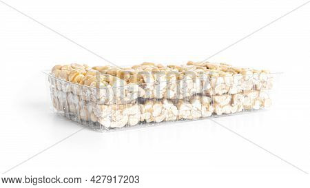 Peanut Brittle Isolated On White Background. Peanuts In Caramel. Natural Candy Bar.