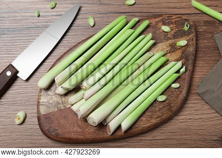 Flat Lay Composition With Fresh Lemongrass Stalks On Wooden Table