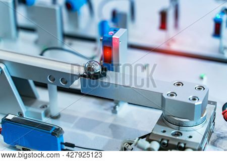 transducer on industrial machine robot in assembly line working in factory. Smart factory industry 4.0 concept.